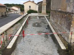 Pose d'une bordure en pavés à Saint Romain